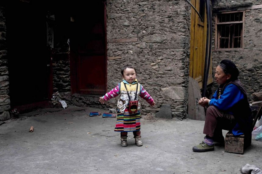 A toddler seen in the village of Kuopo in Longxi township in Sichuan province. China eliminated the one-child policy in 2016 after almost four decades.