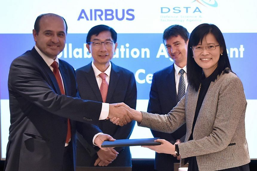 Present at the signing ceremony were (from left) Mr Javier Rivera, vice-president of transport and mission aircraft services at Airbus Defence and Space; Mr Tan Peng Yam, chief executive of DSTA; Mr Johan Pelissier, head of Airbus Defence and Space,