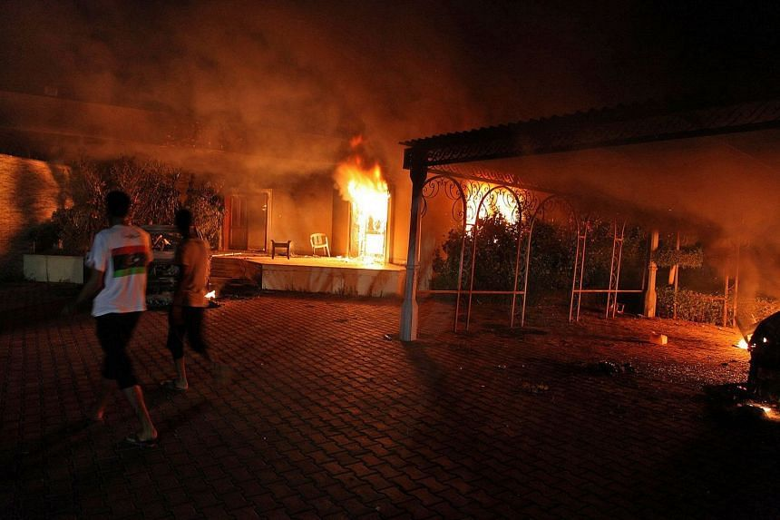 A photo taken on Sept 10, 2012, shows a vehicle and surrounding buildings burning after they were set on fire inside the US consulate compound in Benghazi.
