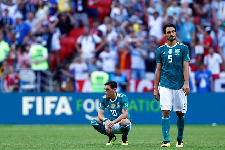 Germany's Mesut Ozil (left) and Mats Hummels react to their World Cup defeat to South Korea at the Kazan Arena.