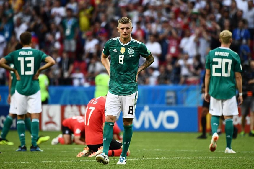 The German trio of (from left) Thomas Muller, Toni Kroos and Julian Brandt react after South Korea's second goal.