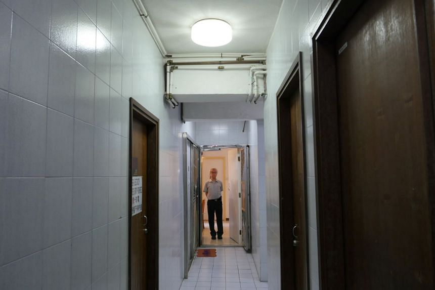 Ng Goon Lau poses inside his property where two suicides have taken place, in Hong Kong, on June 8, 2018.
