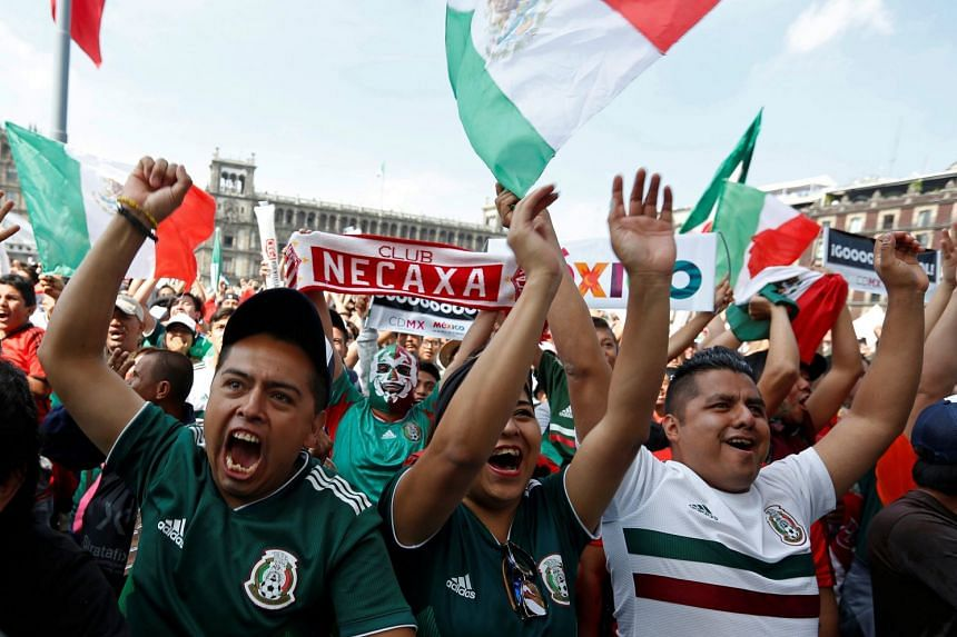 Mexican soccer fans celebrate.