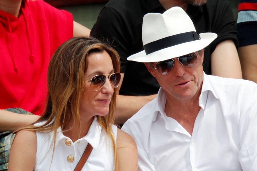 British actor Hugh Grant (right) and his wife Anna Elisabet Eberstein in the stands watching the French Open 2018 final on June 10, 2018.