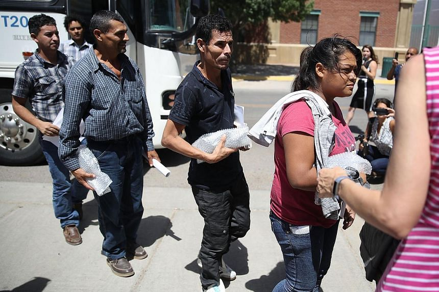 Migrants arriving at the Annunciation House migrant shelter after being released from US Customs and Border Protection custody, on June 24, 2018, in El Paso, Texas.