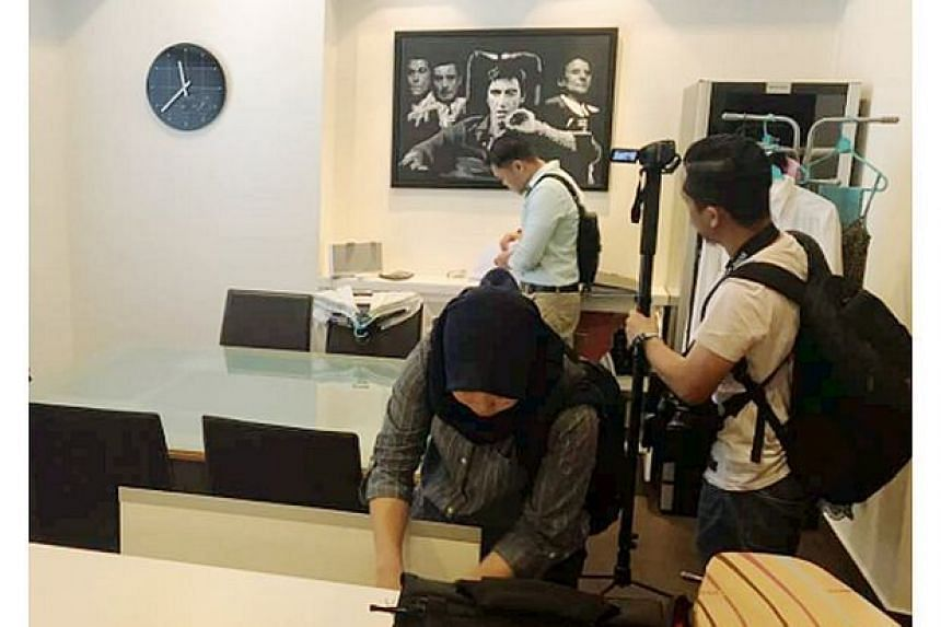 A raiding team from the agency was spotted at a serviced apartment unit in Malaysia's capital Kuala Lumpur belonging to Mr Low, who is better known as Jho Low.