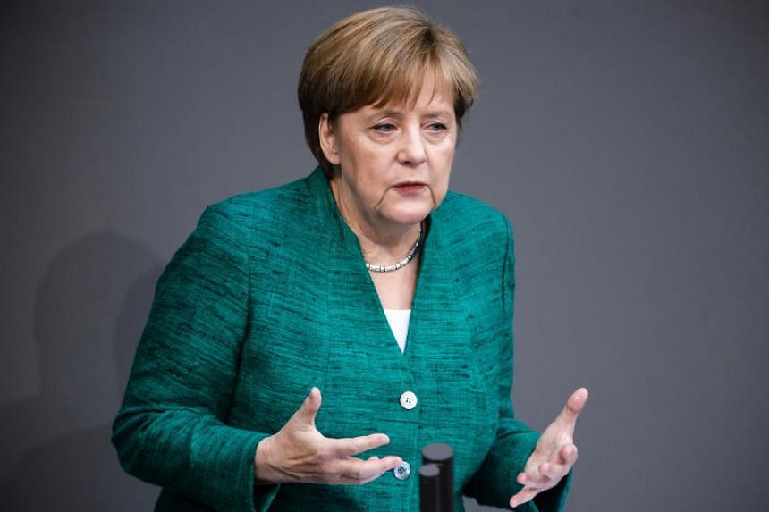 Chancellor Angela Merkel tried to win over critics from within her own ranks, defending her 2015 decision to open Germany's doors to a million migrants as a necessary step of help to its neighbours.