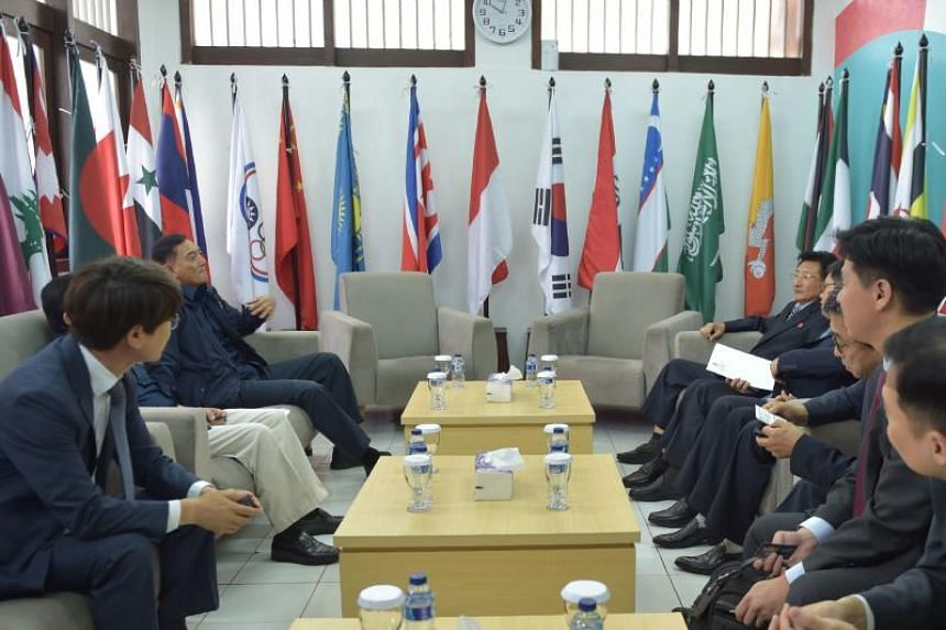 Sjafrie Sjamsoeddin (third from left) of the Indonesian Asian Games Organising Committee speaks to representatives from North and South Korea prior to a meeting with Olympic Council of Asia at its headquarters in Jakarta, on June 28, 2018.