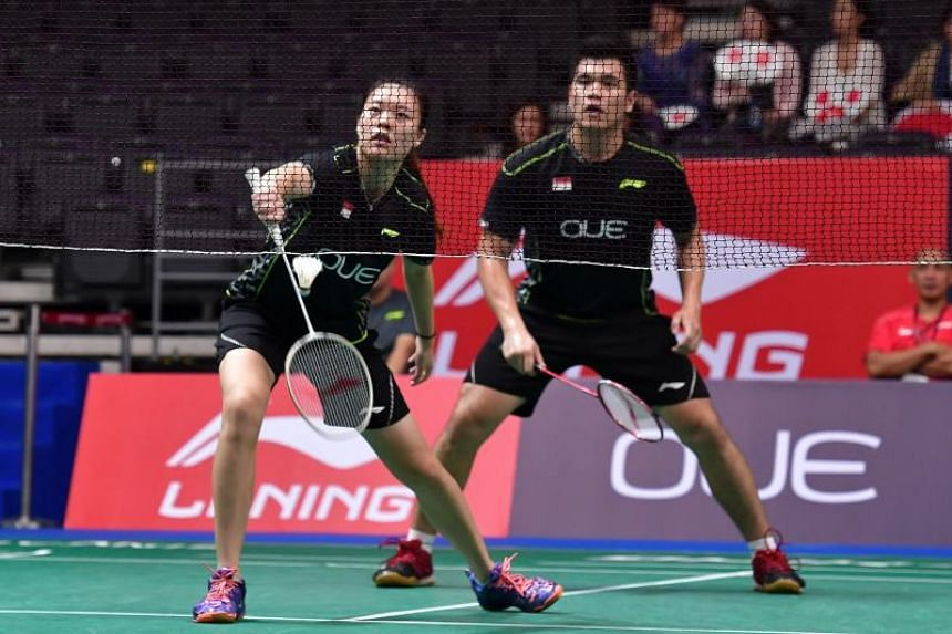 Singapore's Jin Yujia and Bimo Adi Prakoso in action against the Japan's Misaki Matsutomo and Yugoslav Kobayashi (not pictures) during the OUE Singapore Open at the Indoor Stadium on April 11, 2017.