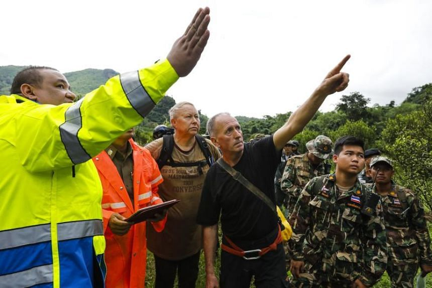 British cave divers with Thai army soldiers and rescue personnel searching for new openings to the cave in Tham Luang-Khun Nam Nang Non Forest Park on June 28, 2018.