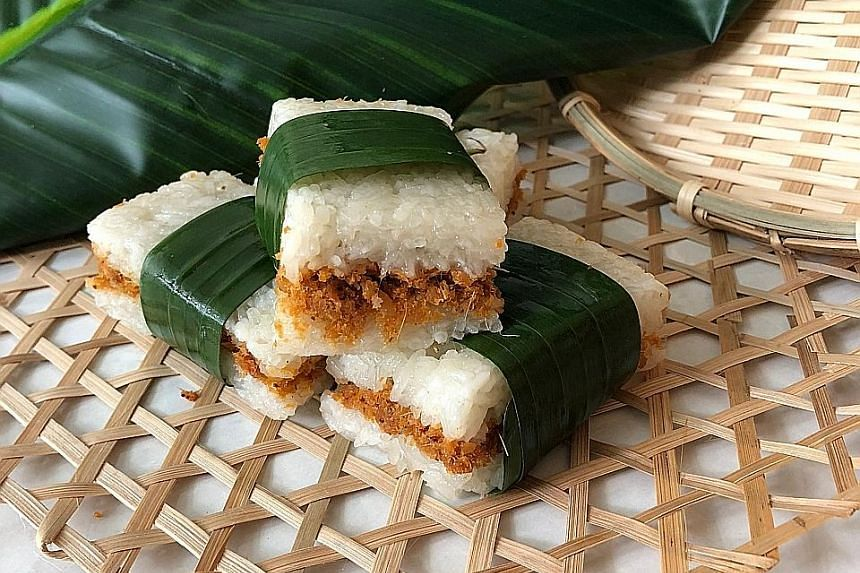 Ollella's lemper ayam ($3 a piece) with shredded chicken braised in coconut milk, lemongrass, candlenuts and other ingredients wrapped in glutinous rice.