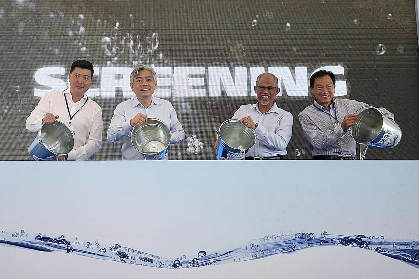 (From left) Construction firm HSL's chief executive Charles Quek, Ministry of the Environment and Water Resources Permanent Secretary Albert Chua, Environment and Water Resources Minister Masagos Zulkifli and PUB chief executive Ng Joo Hee officially