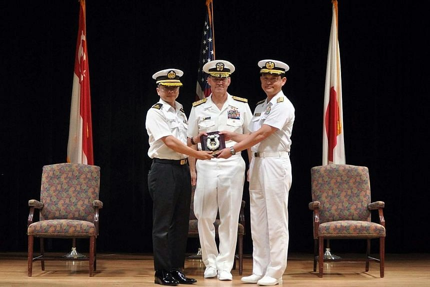 Rear-Admiral Saw Shi Tat (left) taking over command of Combined Task Force 151 from Rear-Admiral Daisuke Kajimoto of Japan, witnessed by Vice-Admiral Scott A. Stearney, Commander of the Combined Maritime Forces, at the change of command ceremony in B