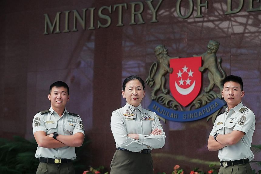 Senior Warrant Officer Jennifer Tan, currently Commanding Officer of the Armour Combat Training Centre, with sons Master Sergeant Jason (left) and MSG Jeffrey Ong. She was among over 500 personnel from Mindef and the SAF to be promoted this year. The