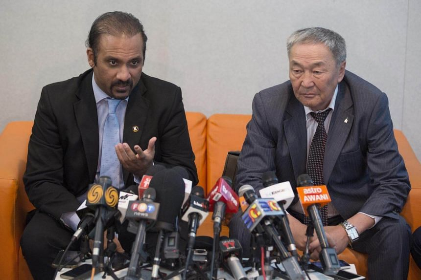 Mongolian Dr Steve Shaariibuu (right), father of murdered Mongolian model Altantuya Shaariibuu, with lawyer Ramkarpal Singh hold a press conference in Putrajaya, on June 19, 2018.
