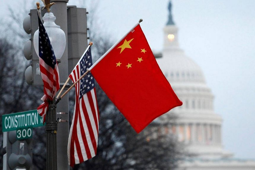 """File photo of the People's Republic of China and US flags on a lamp post. US politicians suspicious of China's intentions were roused when Chinese venture investors were reportedly accessing """"the crown jewels of US innovation"""" in 2017."""