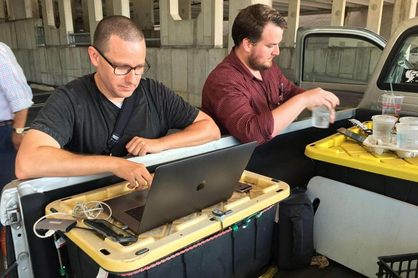 Capital Gazette reporter Chase Cook (right) and photographer Joshua McKerrow work on the next day's newspaper while awaiting news from their colleagues in Annapolis, Maryland, on June 28, 2018.