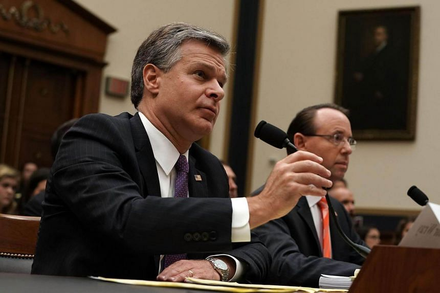 US Deputy Attorney General Rod Rosenstein (right) and FBI Director Christopher Wray testify during a hearing before the House Judiciary Committee in Capitol Hill in Washington, DC, on June 28, 2018.