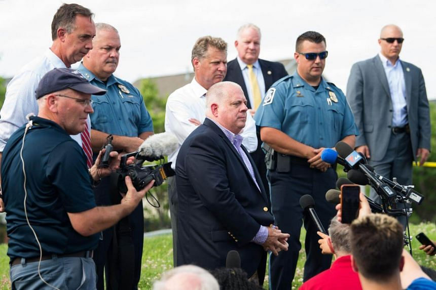 Maryland Governor Larry Hogan (centre) at a press conference following a shooting in Annapolis, Maryland, on June 28, 2018.