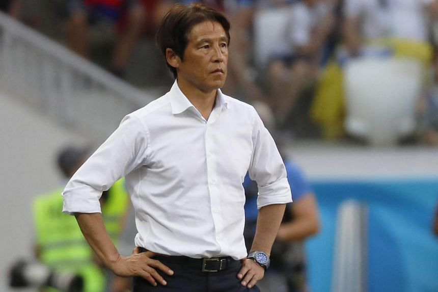 Japan's coach Akira Nishino reacts during the Fifa World Cup 2018 group H preliminary round soccer match between Japan and Poland in Volgograd, Russia, on June 28, 2018.