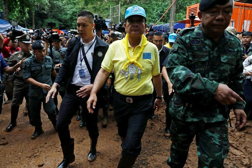 Thailand's Prime Minister Prayut Chan-o-cha arrives at the Tham Luang cave complex during an ongoing search for members of an under-16 soccer team and their coach, in the northern province of Chiang Rai, Thailand, on June 29, 2018.