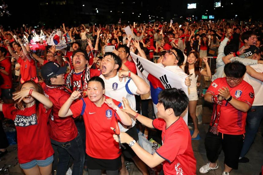 South Koreans rejoicing in Seoul as defender Kim Young Gwon nets a goal in South Korea's the Russia World Cup 2018 Group F football match against Germany at the Kazan Arena, on June 27, 2018.