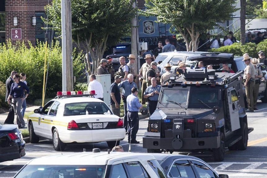 Police respond to a shooting in Annapolis, Maryland, on June 28, 2018.