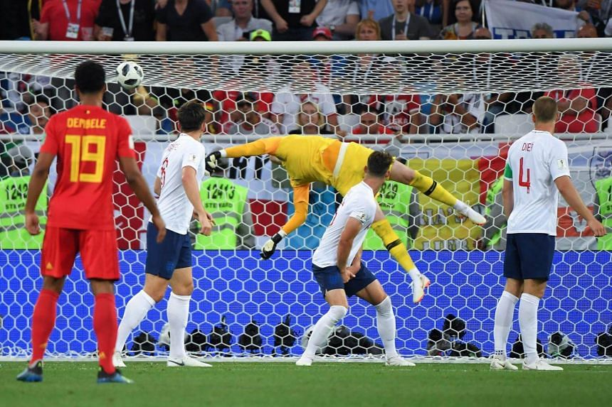 England's goalkeeper Jordan Pickford concedes the opening goal during the Russia 2018 World Cup Group G football match between England and Belgium on June 28, 2018.