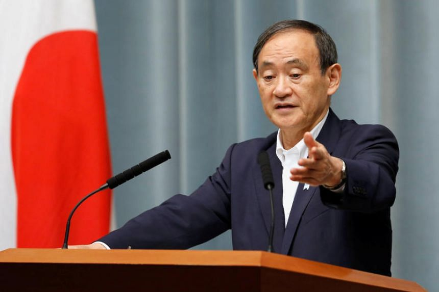 Japan's Chief Cabinet Secretary Yoshihide Suga attends a news conference at Prime Minister Shinzo Abe's official residence in Tokyo on May 29, 2017.