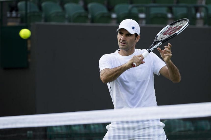 Roger Federer of Switzerland in action during a training session at the All England Lawn Tennis Championships in Wimbledon on June 28, 2018.