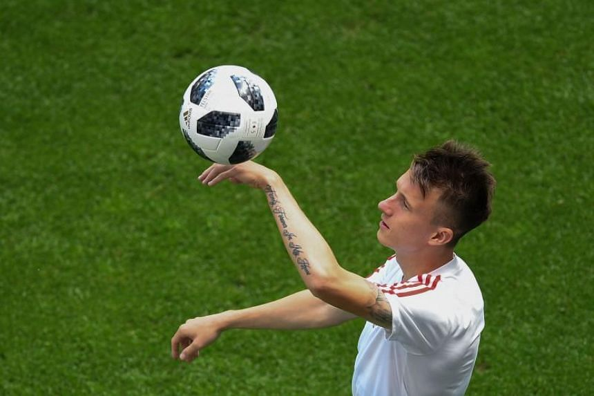 Russia's midfielder Aleksandr Golovin takes part to a training session on the eve of the Russia 2018 World Cup Group A football match between Russia and Uruguay at the Samara Arena on June 24, 2018 in Samara.