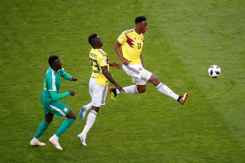 Colombia's Yerry Mina and Davinson Sanchez in action with Senegal's M'Baye Niang at the Samara Arena, Samara, Russia, on June 28, 2018.