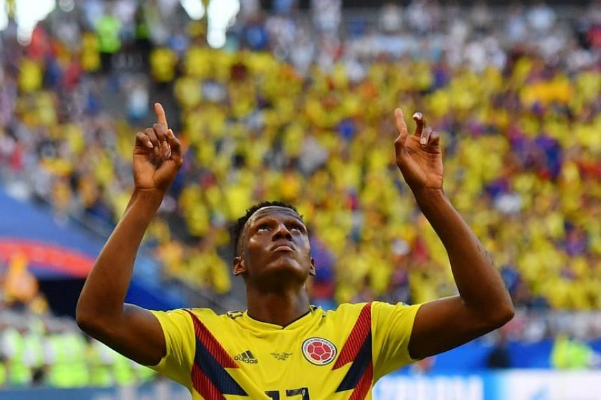 Colombia's defender Yerry Mina celebrates after scoring a goal during the Russia 2018 World Cup Group H football match between Senegal and Colombia at the Samara Arena in Samara on June 28, 2018.