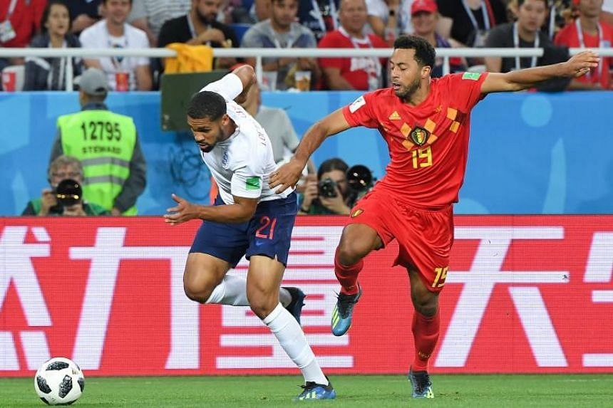 England's midfielder Ruben Loftus-Cheek (left) vies with Belgium's midfielder Moussa Dembele during the Russia 2018 World Cup Group G football match between England and Belgium at the Kaliningrad Stadium in Kaliningrad on June 28, 2018.