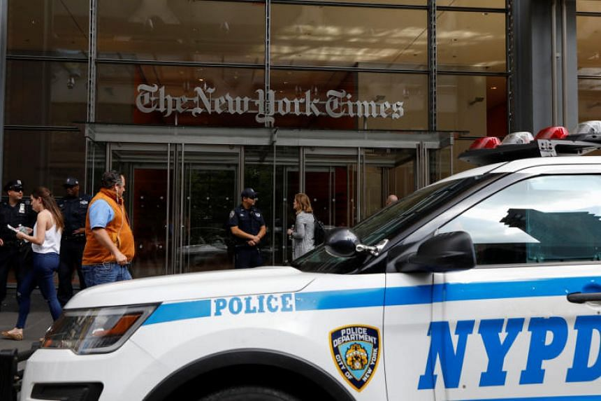 New York Police officers are seen deployed outside the New York Times building following a fatal shooting at a Maryland newspaper, in New York City, US, June 28, 2018.