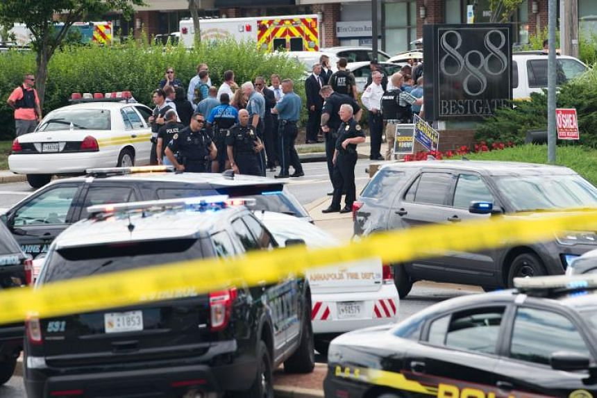 Police respond to a shooting at the offices of the Capital Gazette, a daily newspaper, in Annapolis, Maryland, on June 28, 2018.