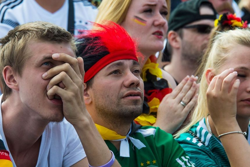 Fans at a public viewing event in Berlin reacting to Germany's defeat by South Korea in the Russia 2018 World Cup Group F football match, on June 27, 2018.