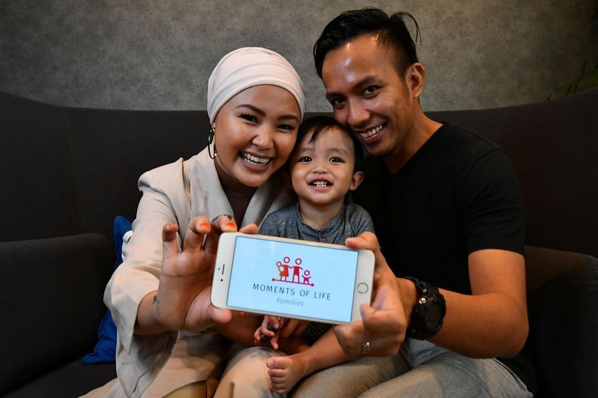 Freelance content creator Ateeqah Mazlan with her son and husband, Mr Rostam Effendie Yacob. Madam Ateeqah, whose son is turning two, said the app is a one-stop shop for new parents.