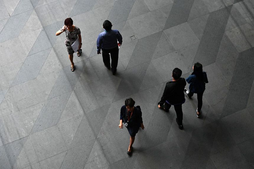 """A file photo of office workers in the financial district of Singapore. The study also found that board gender diversity has a """"positive and statistically significant"""" impact on corporate governance."""