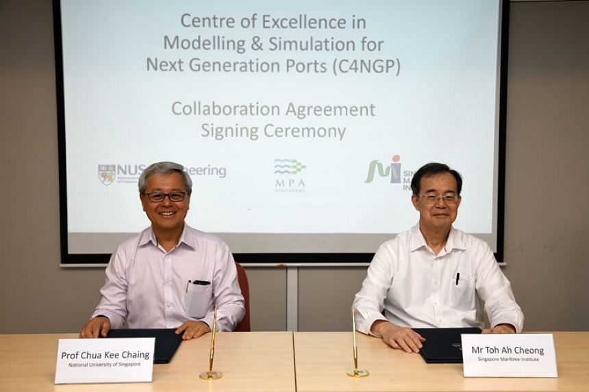Professor Chua Kee Chaing, dean of the National University of Singapore's Faculty of Engineering, and Mr Toh Ah Cheong, executive director of Singapore Maritime Institute, at the signing of the agreement to set up the Centre of Excellence in Modellin