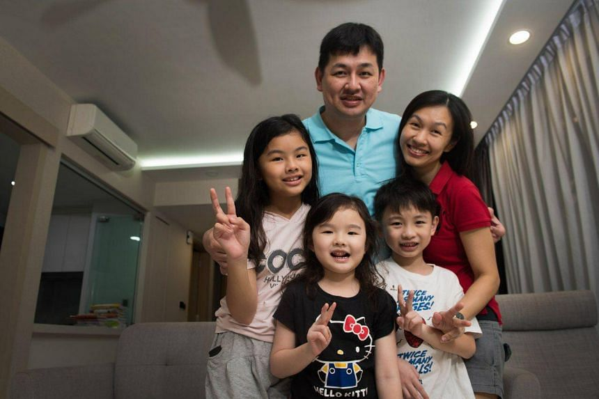 Mrs Lee Ah Nee with her husband Bryan Lee Ooi Chiang and their children Cherise  (left) and Kayson (right), who are already in Chong Fu Primary School, and Celeste, who is set to register for Primary 1.