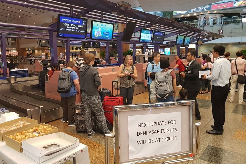 Many travellers did not know of the last-minute cancellations before arriving at Changi Airport for their flights.