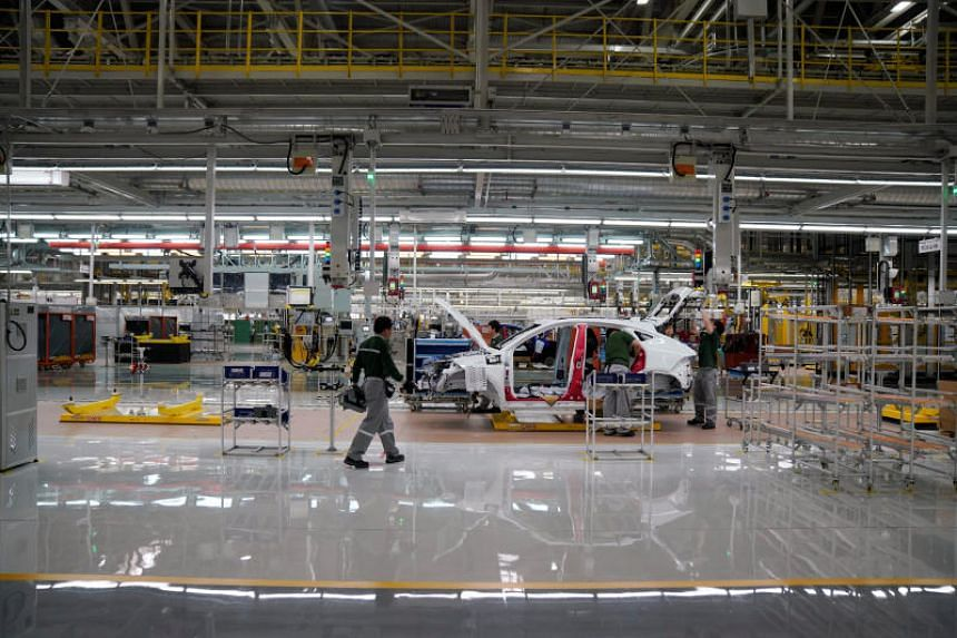 Employees work at the production line inside the Chery Jaguar Land Rover plant phase 2 in Changshu, China, on June 27, 2018.
