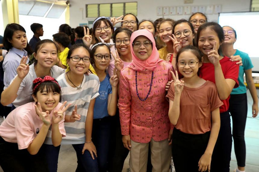 President Halimah Yacob with student performers at the Voice-for-Change carnival, on June 29, 2018. Madam Halimah said more can be done on a broader level to provide a nurturing environment for the youth.