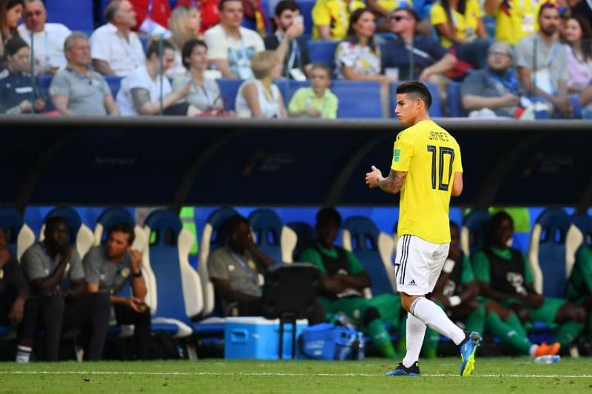 Colombia's midfielder James Rodriguez reacts as he leaves the football pitch due to an injury during the Russia 2018 World Cup Group H football match between Senegal and Colombia at the Samara Arena on June 28, 2018.