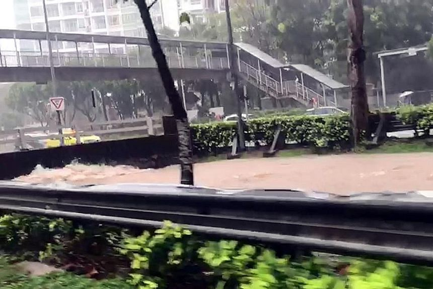 The Bukit Timah Canal brimming with water during yesterday morning's downpour. PUB said about 85mm of rainfall was recorded between 9.30am and 11.30am. The average rainfall for June is 130.7mm.