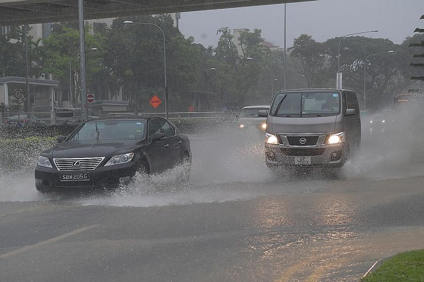Vehicles negotiating a flooded stretch at King Albert Park MRT station in Dunearn Road at 10.45am yesterday. Areas which saw flooding included Lorong Kismis in Upper Bukit Timah, Dunearn Road and Bukit Timah.