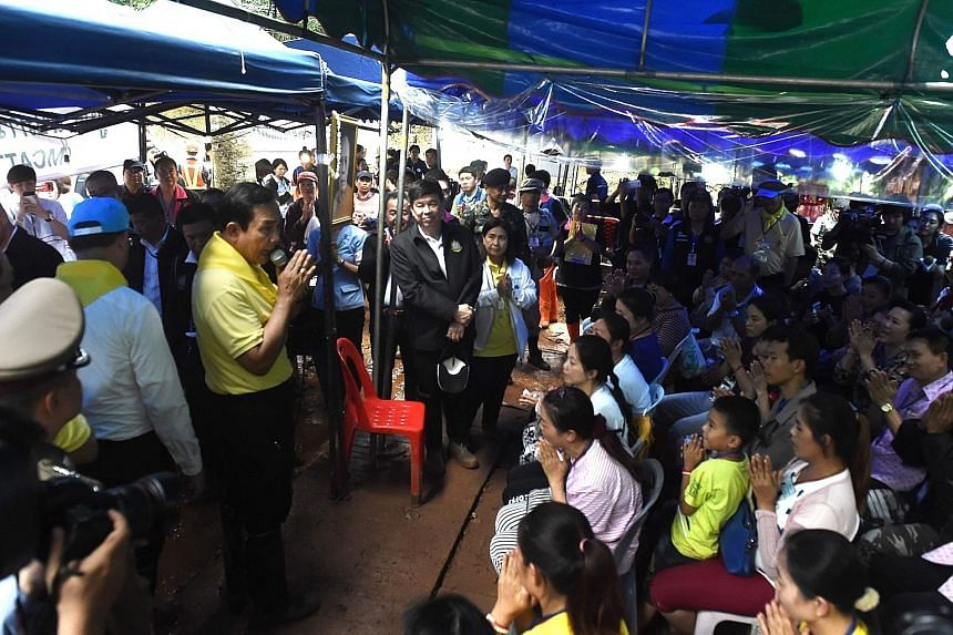 Thai Premier Prayut Chan-o-cha talking to relatives of the missing 13 yesterday.