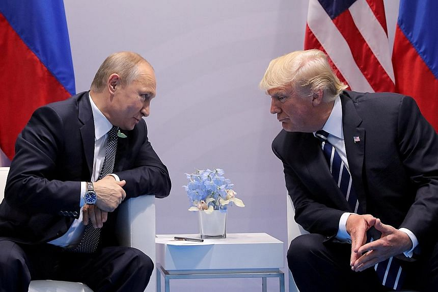 Russian President Vladimir Putin talking to US President Donald Trump during a bilateral meeting at the Group of 20 summit in Germany last July. The two leaders will meet again in Helsinki on July 16.