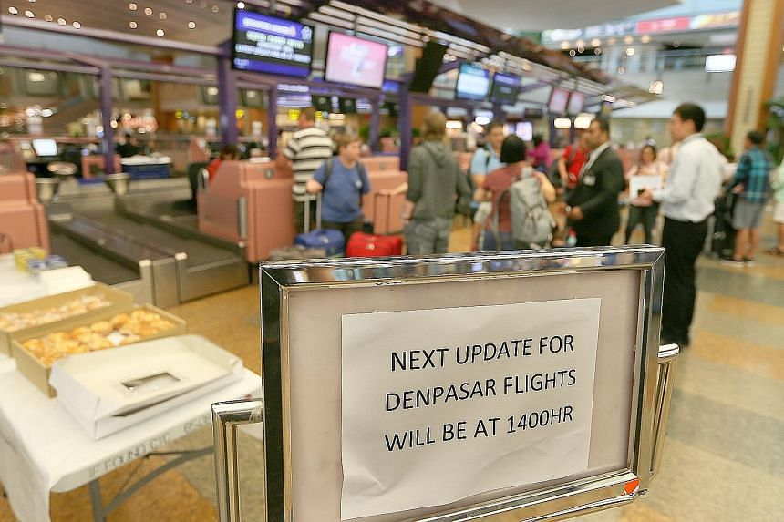 A sign put up at SIA's counter at Changi Airport's Terminal 2. The airline waived fees for passengers switching to another Asean destination.